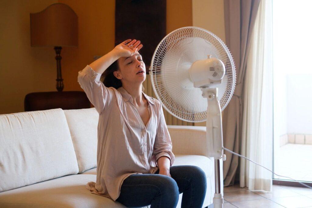 Woman in front of fan.